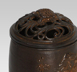 Cylindrical shape with pine, bamboo and plum pattern(together an auspicious grouping)